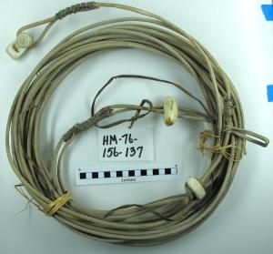 Baidarka cord with ivory carvings PM 1976-156-0137