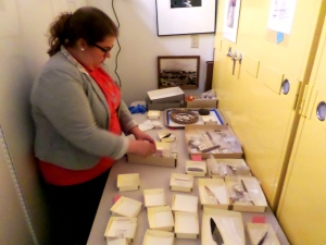 Savanna Bradley working on organizing selected pieces for photographing.